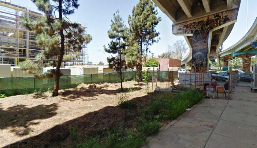 The proposed Barrio Logan community garden might go beneath the San Diego-Coronado Bridge, just east of the Mercado del Barrio project, seen here under construction in 2012.