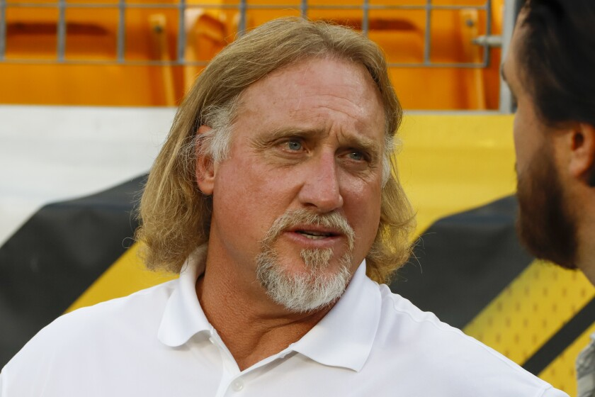 Pro Football Hall of Fame outside linebacker Kevin Greene stands on the sideline.