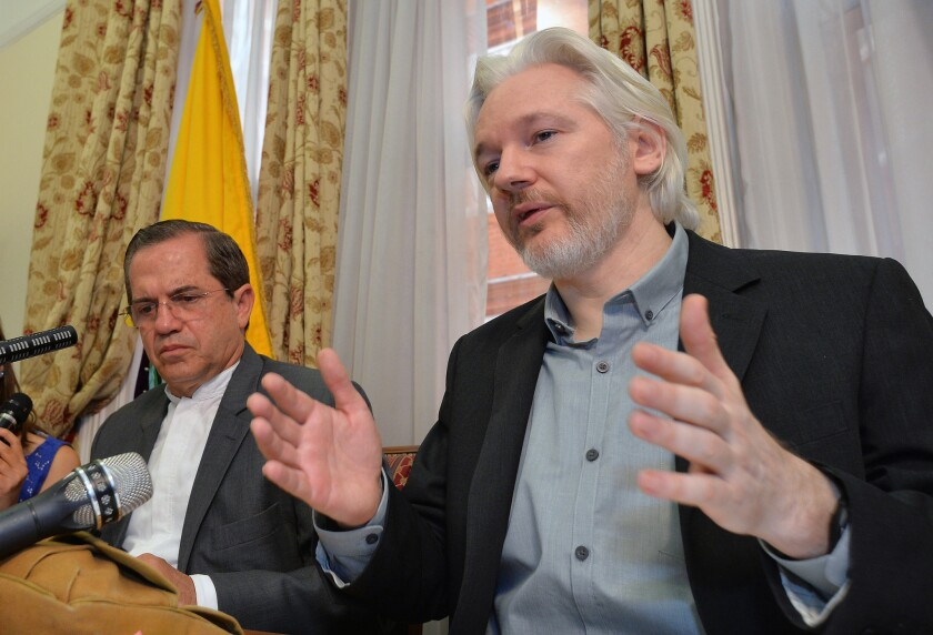 Ecuadorean Foreign Minister Ricardo Patino, left, and WikiLeaks founder Julian Assange speak during an Aug. 18, 2014, news conference inside the Ecuadorean Embassy in London.