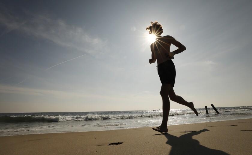 Denton Wright of Westwood runs at Malibu Lagoon State Beach.