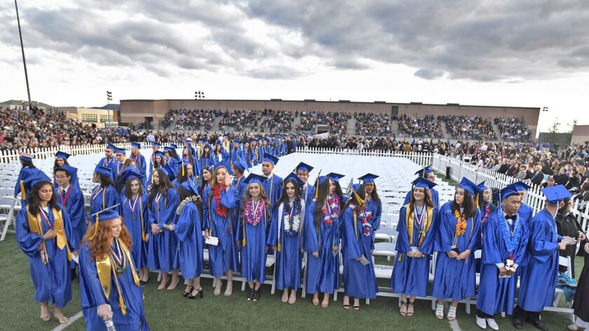 Graduating seniors file in to their seats at the start of the Burbank High School graduation ceremon