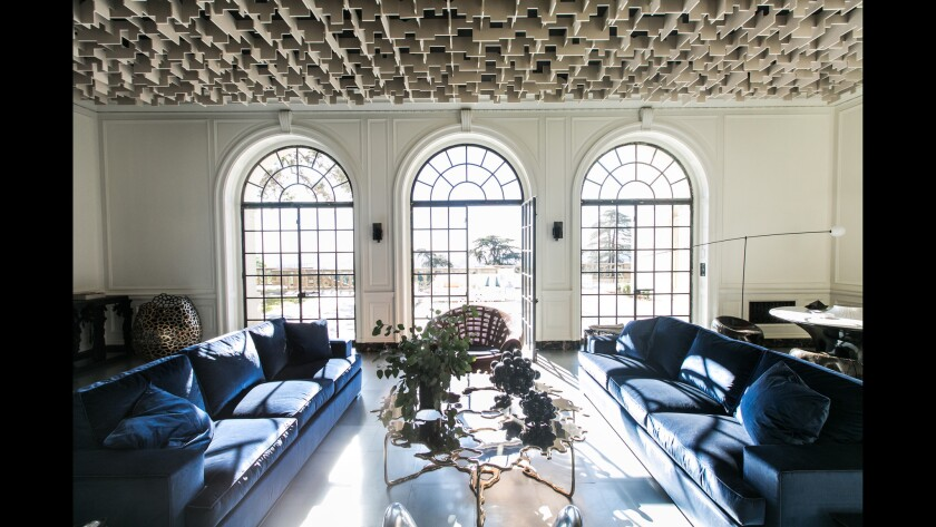 On the first floor of the historic Greystone Mansion in Beverly Hills, designer Oliver M. Furth has re-envisioned the reception hall with a ceiling of recycled plastic and steel tile flooring.