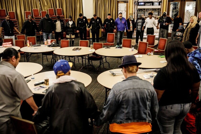 LOS ANGELES, CALIF. -- WEDNESDAY, APRIL 3, 2019: Participants gather for a prayer at the end of the