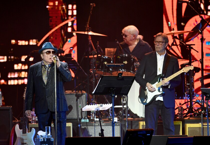 Van Morrison (L) and Eric Clapton perform at London's O2 Arena on March 3, 2020