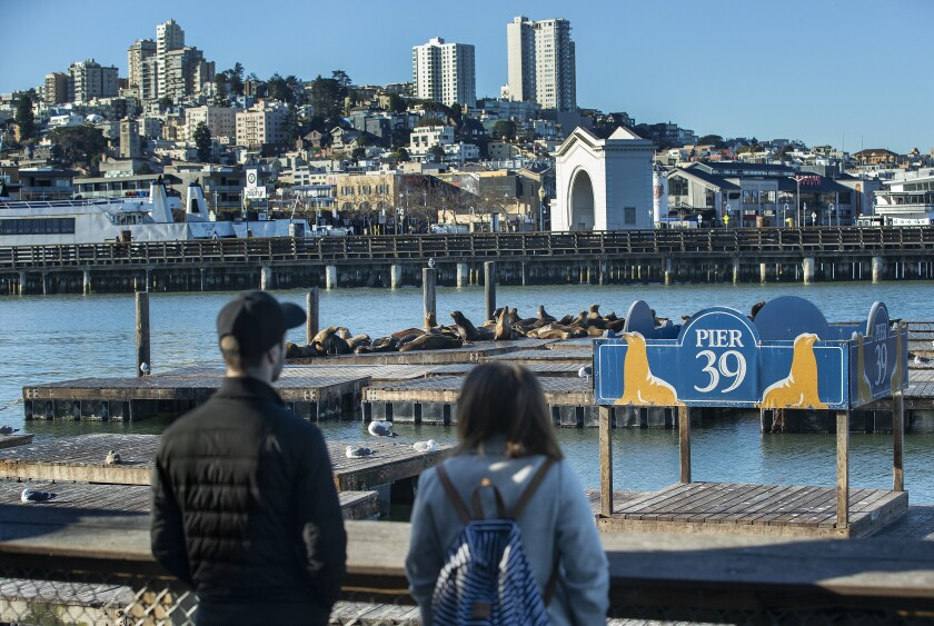 Visitors to Pier 39 in San Francisco