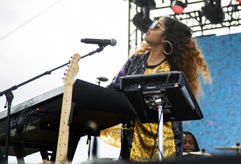 LONG BEACH, CA - JUNE16, 2018: H.E.R performs during Smokin Groves, a day-long blowout of alternati