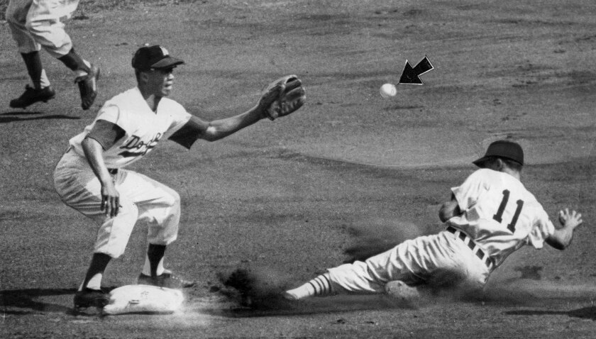 Oct. 5, 1959: White Sox Luis Aparicio steals second ahead of throw to Maury Wills, left, from Wally Moon. Game 4 of the 1959 World Series.