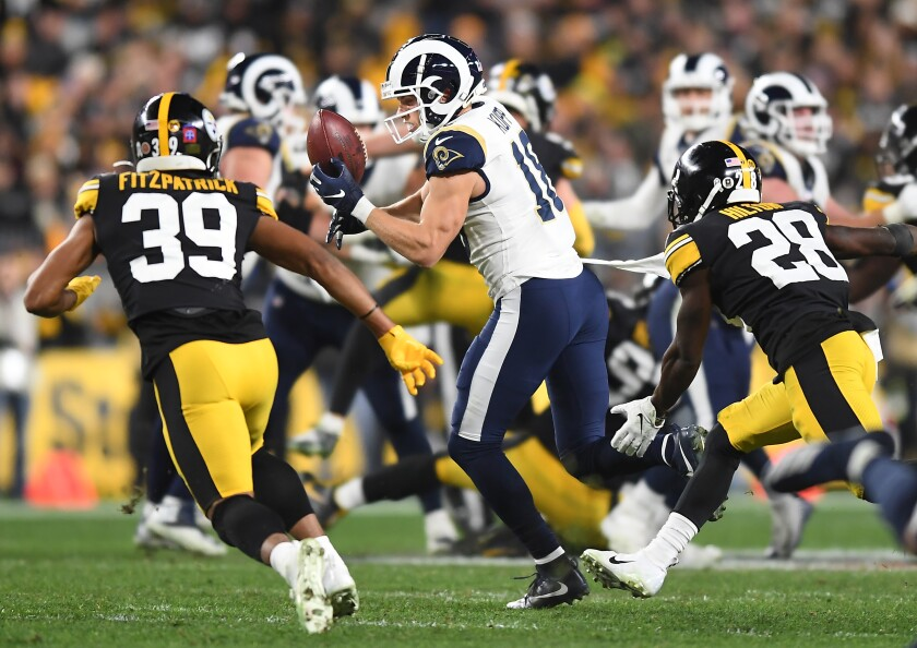 Rams receiver Cooper Kupp drops a pass as Steelers safety Minkah Fitzpratrick (39) and cornerback Mike Hilton pursue. Kupp went