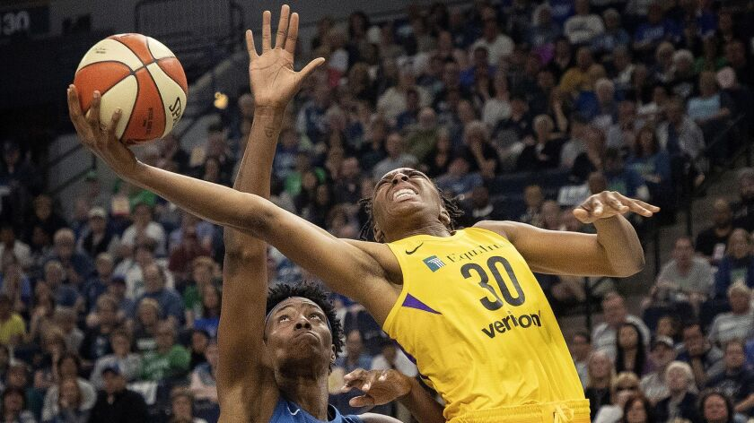 Sparks forward Nneka Ogwumike attempts a layup against Lynx center Sylvia Fowles during a WNBA game on May 20, 2018.