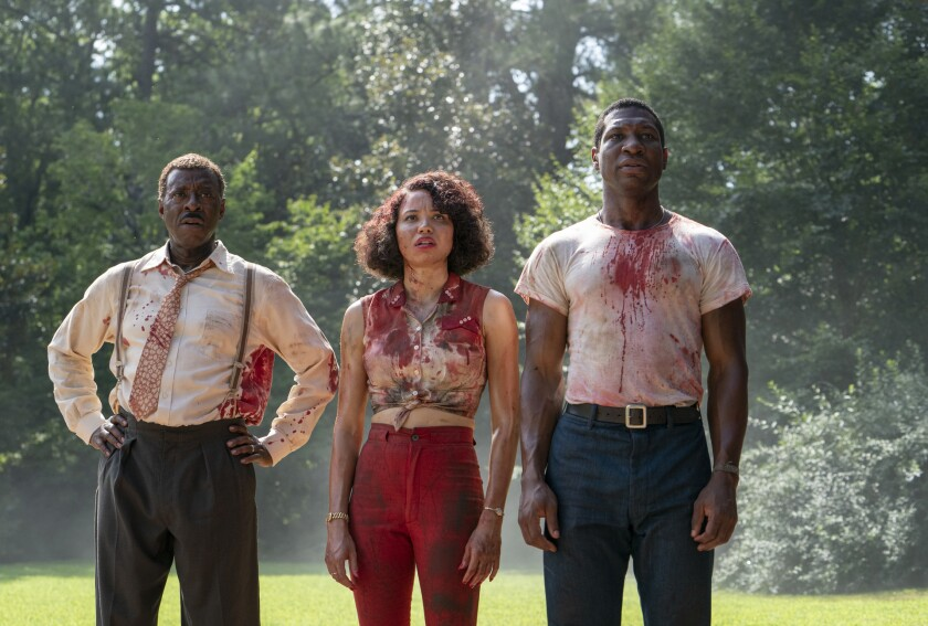 """This image released by HBO shows, from left, Courtney B. Vance, Jurnee Smollett and Jonathan Majors in a scene from """"Lovecraft Country."""" The program was nominated for an Emmy Award for outstanding drama series. (HBO via AP)"""