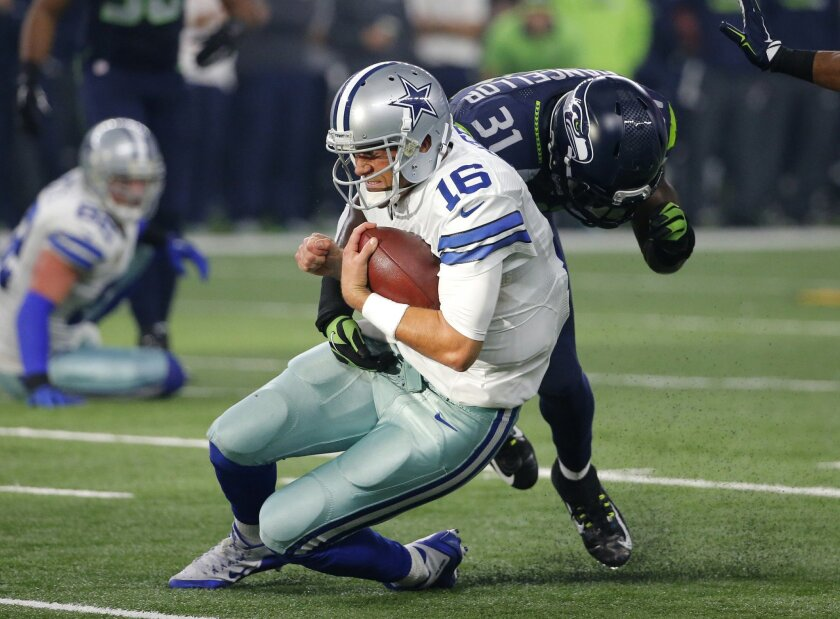 Dallas Cowboys' Matt Cassel is tackled by Seattle Seahawks' Kam Chancellor (31) after running for a first down in the first half of an NFL football game Sunday, Nov. 1, 2015, in Arlington, Texas. (AP Photo/Brandon Wade)