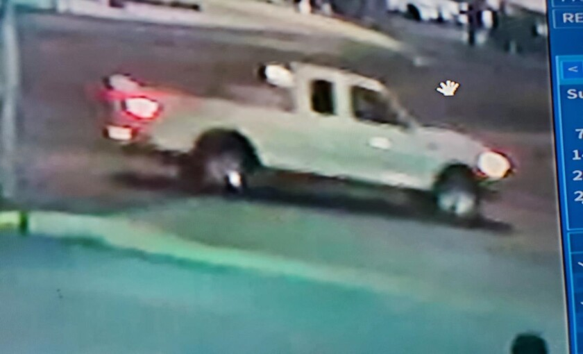 Surveillance image of white pickup truck