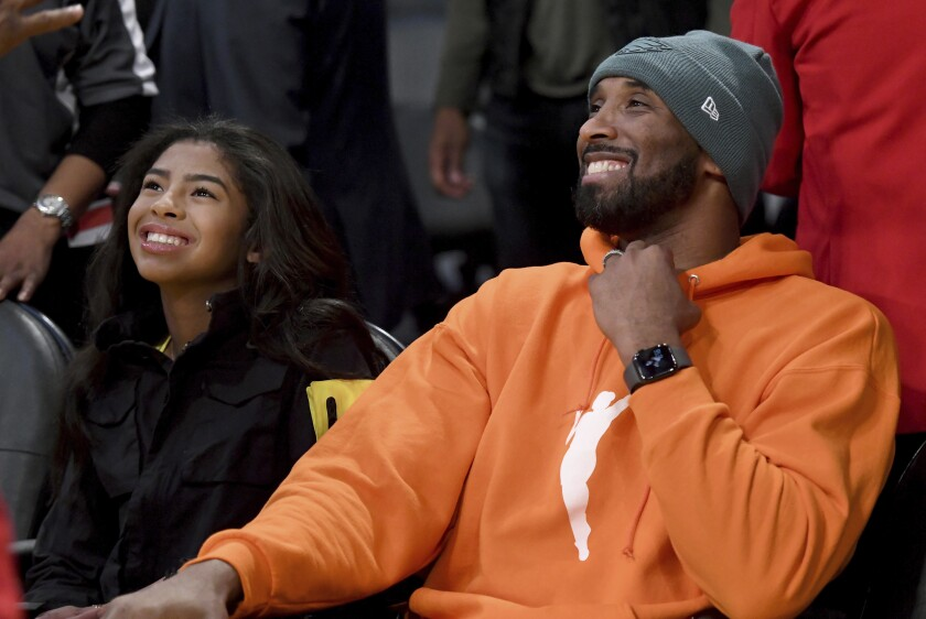 Kobe Bryant and his daughter Gianna attend a game between the Lakers and Dallas Mavericks on Dec. 29, 2019.