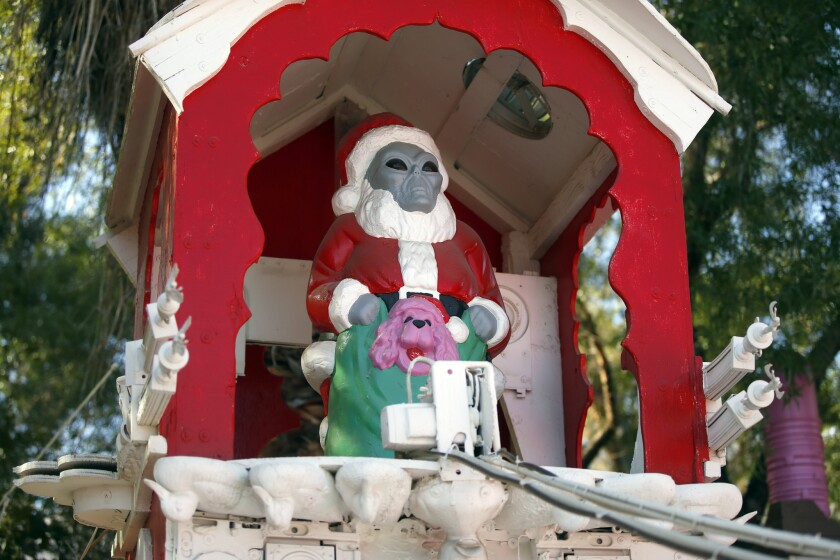 An alien Santa on a rocket sleigh is one of the many quirky displays in artist Kenny Irwin's Robolights installation in his Palm Springs backyard. For fun, you can stare at this photo while listening to strange takes on Christmas music listed below.