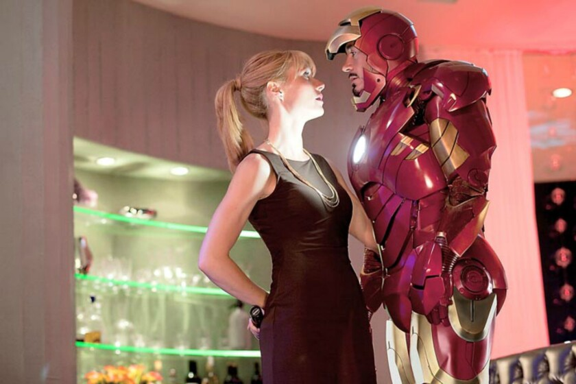 "The man or the mask? Characters are king in Hollywood, but it was movie star Robert Downey Jr., seen here with Gwyneth Paltrow, who made ""Iron Man"" and the Marvel Cinematic Universe so strong at the box office."