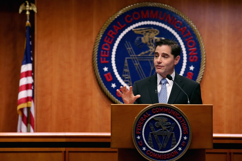 A photo of then-Federal Communications Commission Chairman Julius Genachowski announcing his plan last March to step down after one four-year term. Genachowski led the commission's effort to adopt the Net neutrality rules that a federal appeals court largely rejected on Tuesday.