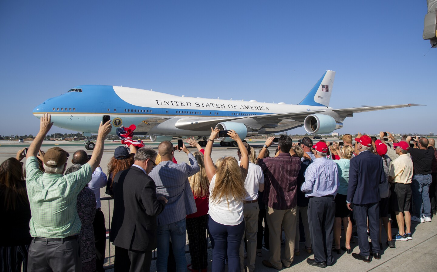 People greet Air Force One at LAX