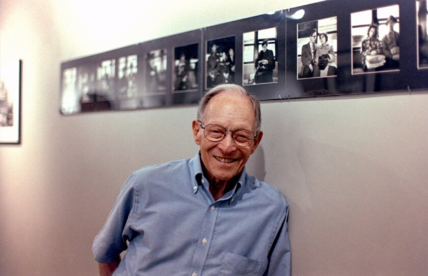 Arthur Lavine with some of his photographs at an exhibit at the PhotoGraphic Gallery in New York City in 2006.