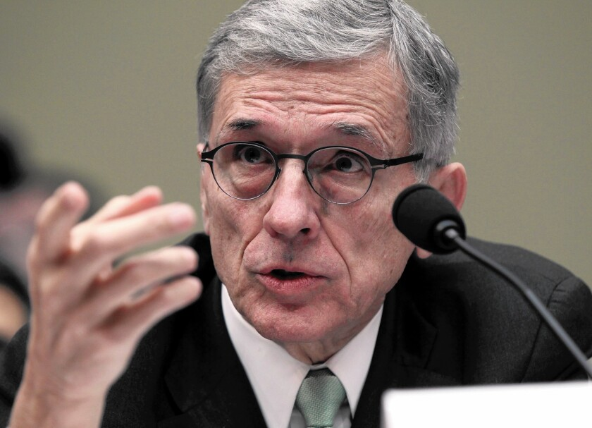 FCC Chairman Tom Wheeler testifies before the House Oversight and Government Reform Committee hearing on net neutrality.