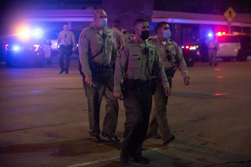 Los Angeles County sheriff's deputies gather at St. Francis Medical Center after two deputies were shot.