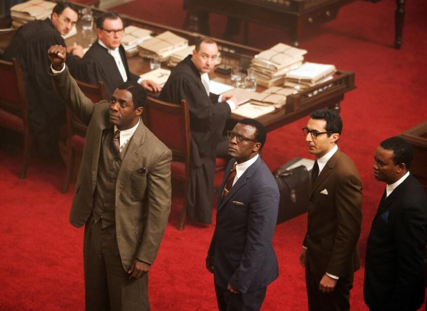 "Idris Elba, left, plays Nelson Mandela in ""Mandela: Long Walk to Freedom."""