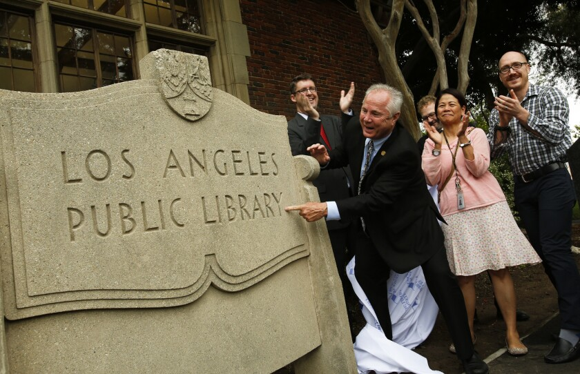Los Angeles City Councilman Tom LaBonge unveils a historic monument at the Memorial Branch Library on June 24, 2013.