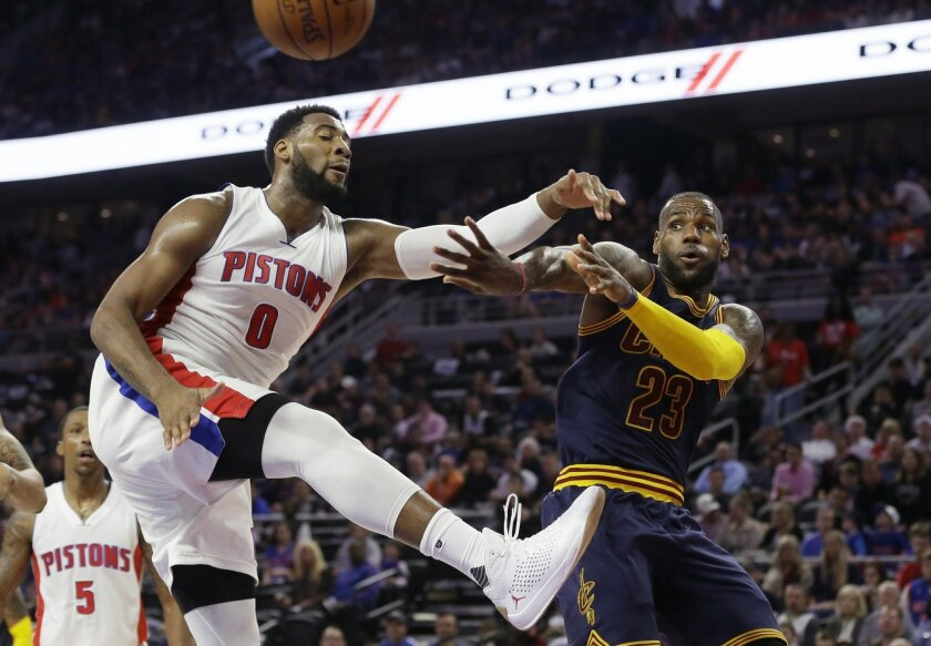 FILE - In this April 22, 2016 file photo, Cleveland Cavaliers forward LeBron James (23) passes around Detroit Pistons center Andre Drummond (0) during the second half in Game 3 of a first-round NBA basketball playoff series in Auburn Hills, Mich.  The  Pistons were negotiating a five-year maximum c