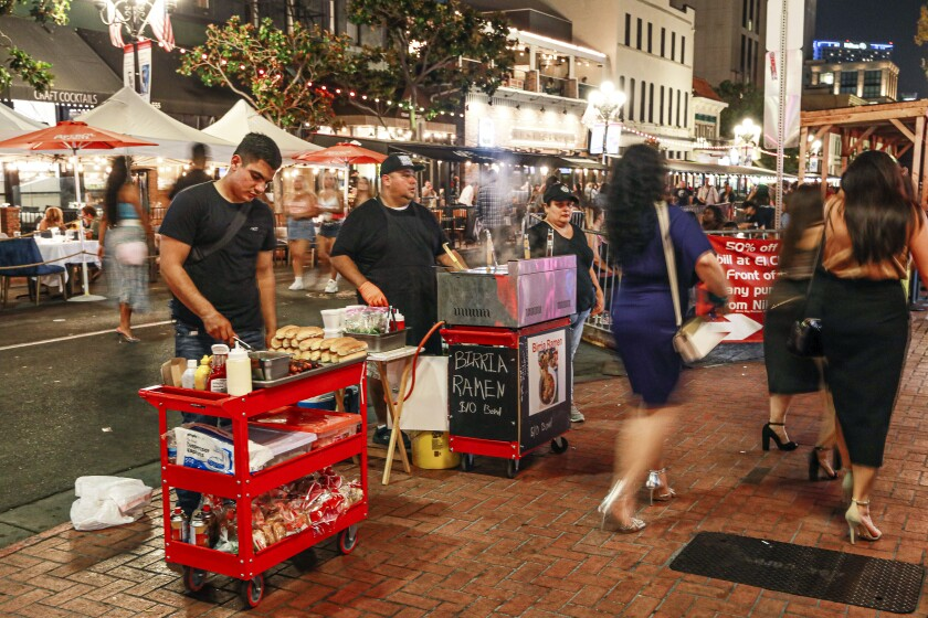 Street vendors sell food along 5th Avenue in the Gaslamp Quarter on Saturday, August 27, 2021.