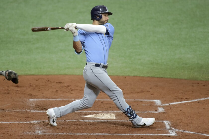 FILE - In this Saturday, July 11, 2020, file photo, Tampa Bay Rays' Kevin Kiermaier bats during baseball practice in St. Petersburg, Fla. (AP Photo/Mike Carlson, File)