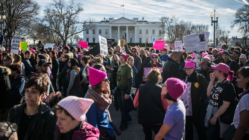 In January, Women's March attendees gather in front of the White House.