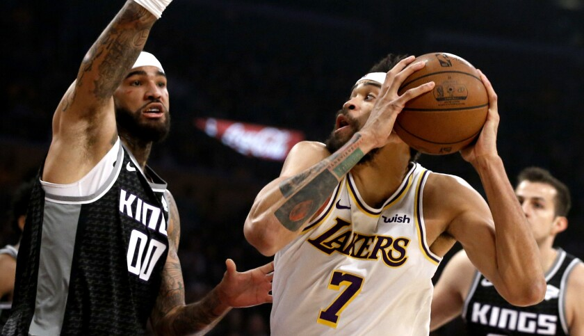 Los Angeles Lakers center JaVale McGee (7) looks to shoot against Sacramento Kings center Willie Cau