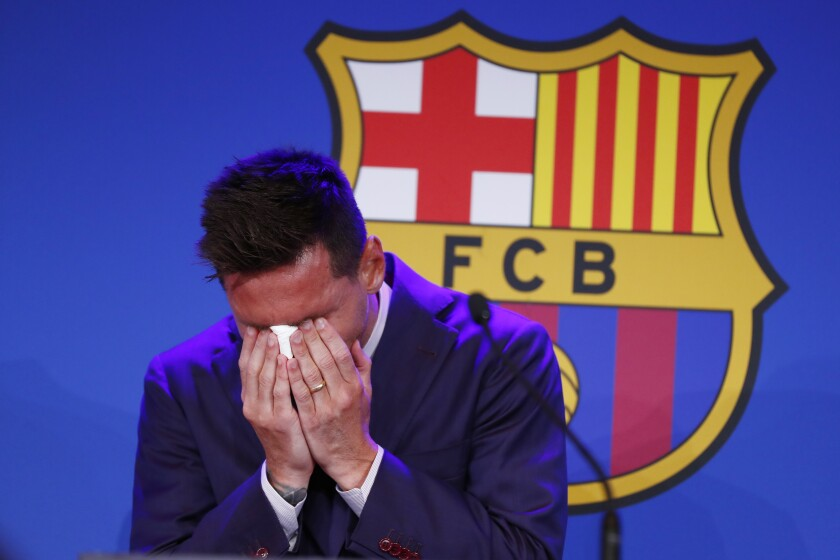 Lionel Messi cries at the start of a press conference at the Camp Nou stadium in Barcelona