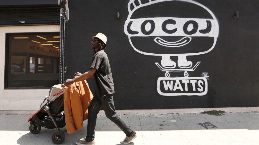 LOS ANGELES, CA – AUGUST 21, 2018: Eric Hayden walks past Locol restaurant in Watts on Thursday Au