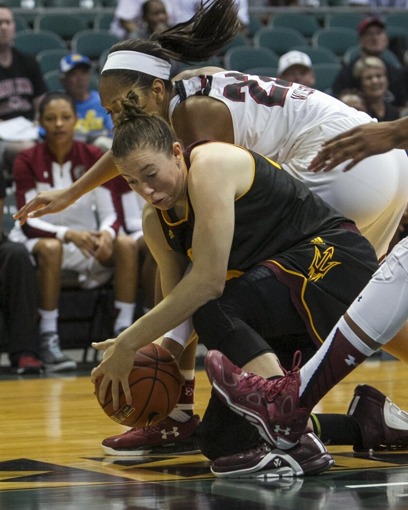 CORRECTS TO ARIZONA STATE, INSTEAD OF ARIZONA - Arizona State forward Eliza Normen, center, struggles to keep a loose ball away from South Carolina defenders during the second half of an NCAA college basketball game, Friday, Nov. 27, 2015 in Honolulu. (AP Photo/Marco Garcia)