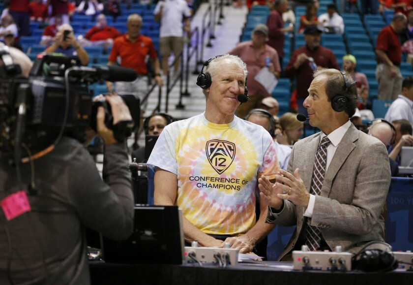 In this March 11, 2016 photo, analyst Bill Walton, left, speaks with play-by-play announcer Ted Robinson before a Pac-12 conference tournament game in Las Vegas. A Walton-called basketball game is like performance art, viewers left buzzing and maybe a little confused when it's over. (AP Photo/John Locher)