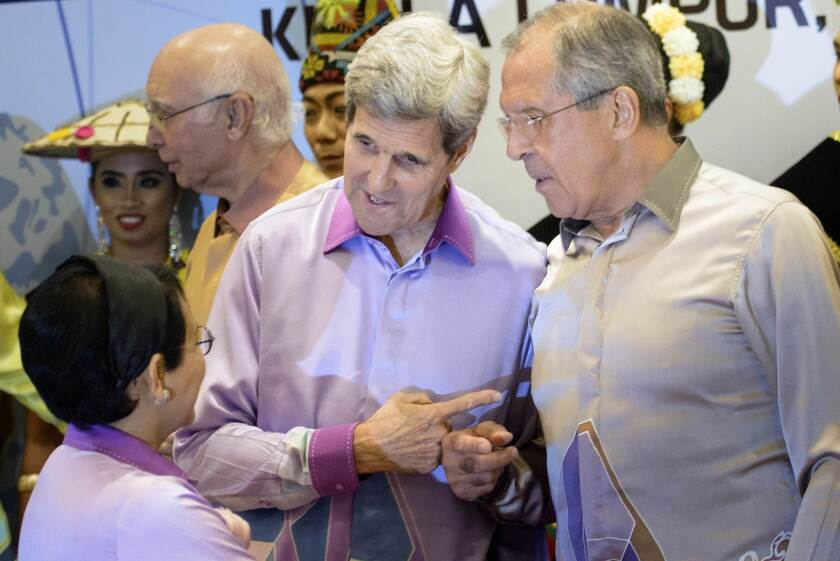 U.S. Secretary of State John F. Kerry, center, and Russian Foreign Minister Sergei Lavrov, right, chat with their Indonesian counterpart, Retno L.P. Marsudi, during Wednesday's meeting of the Assn. of Southeast Asian Nations.