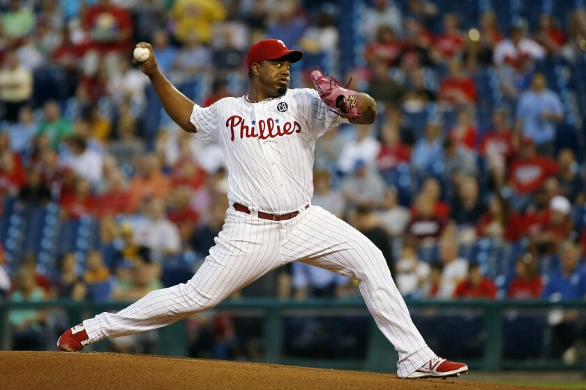 Philadelphia Phillies' Jerome Williams pitches during the first inning of a baseball game against the Pittsburgh Pirates, Wednesday, Sept. 10, 2014, in Philadelphia. (AP Photo/Matt Slocum)