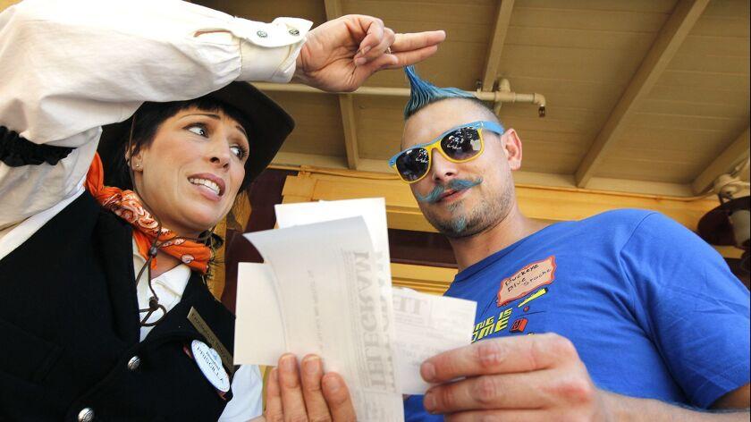 ANAHEIM-CA-JULY 22, 2014: Jennifer Bascom, left, of Disneyland, gives a telegram to Disneyland guest