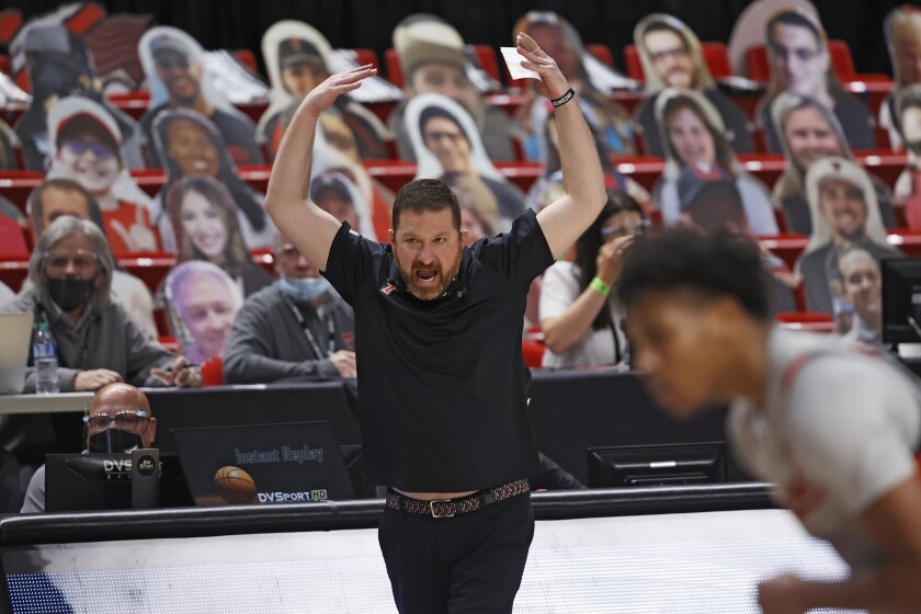 Texas Tech coach Chris Beard tries to get the crowd to cheer during the second half of an NCAA college basketball game against Oklahoma, Monday, Feb. 1, 2021, in Lubbock, Texas. (AP Photo/Brad Tollefson)