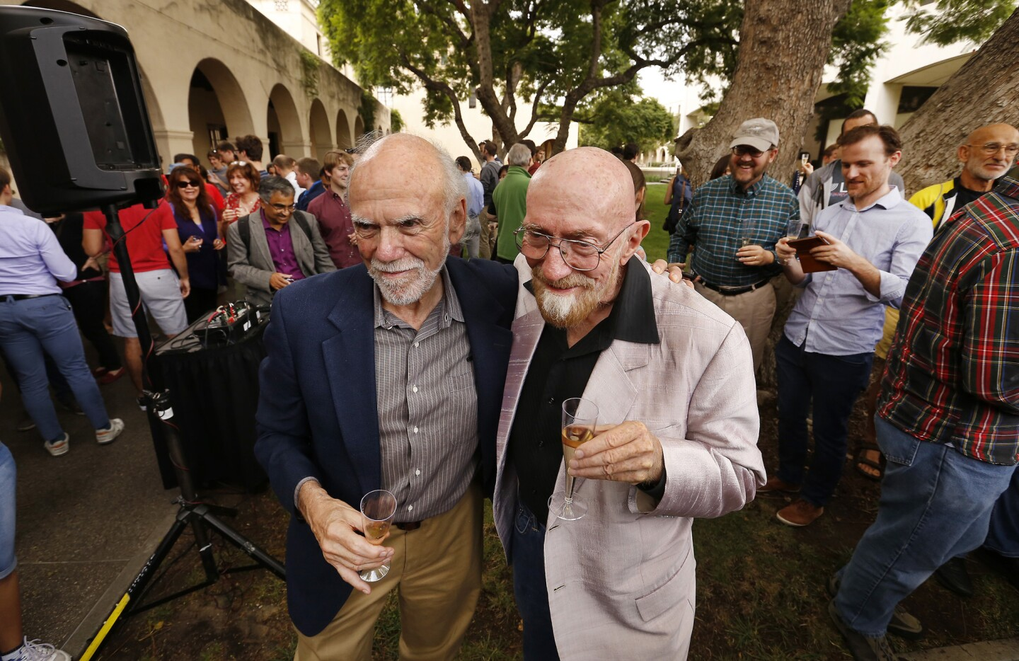 Caltech physicists Barry Barish, left, and Kip Thorne celebrate their Nobel Prize in physics for the LIGO experiment at a party at the Pasadena university.