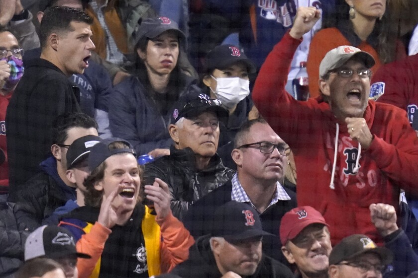 Former New York Yankees Bucky Dent (middle in Yankees cap) watches as Boston Red Sox fans cheer after Yankees' Brett Gardner struck out in the seventh inning of the American League Wild Card playoff game against the Boston Red Sox at Fenway Park, Tuesday Oct. 5, 2021 in Boston. (AP Photo/Charles Krupa)