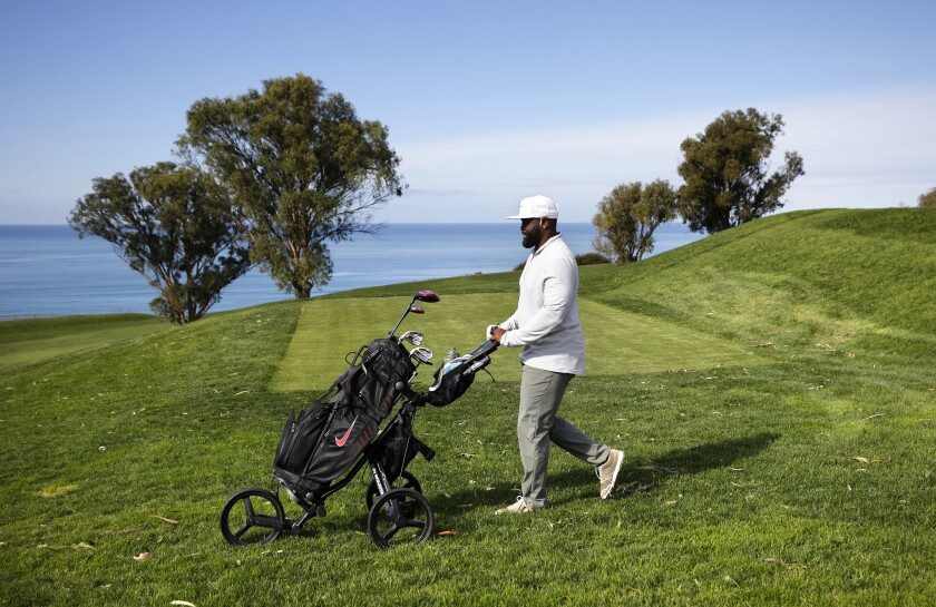 Tony Gwynn Jr. walks the North Course at Torrey Pines while playing with Scottie Scheffler in Farmers Insurance Open pro-am.