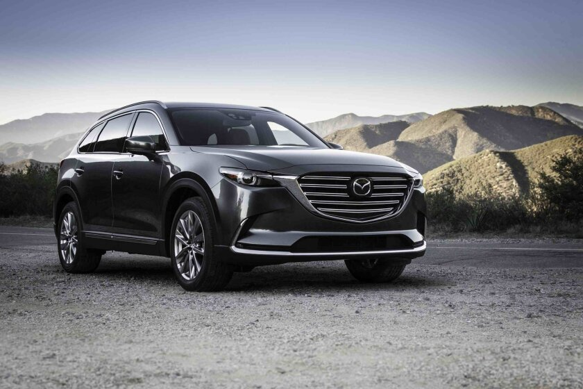 This photo provided by Mazda shows the 2016 Mazda CX-9. Mazda's largest SUV, the CX-9, is extensively revamped for 2016 and comes with a turbocharged four cylinder. (Mike Ditz/Courtesy of Mazda via AP)
