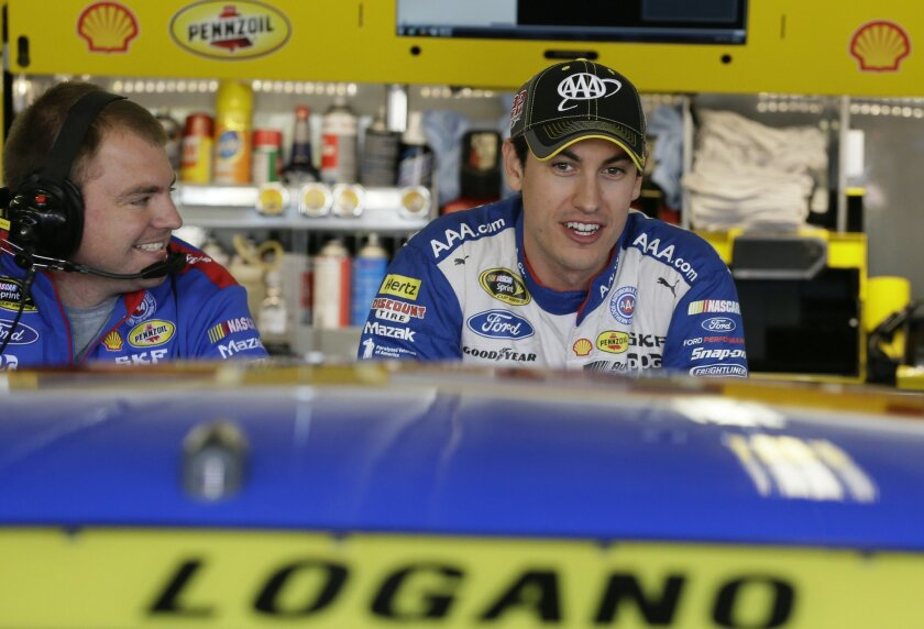 Joey Logano chats in the garage before the start of NSACAR Sprint Cup auto race practice at Texas Motor Speedway Friday, Nov. 6, 2015, in  Fort Worth, Texas. Logano's championship hopes took a significant blow when he was intentionally wrecked by Matt Kenseth. Logano goes to Texas last among the ei