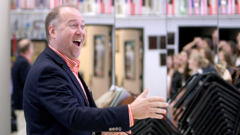 Burbank High show choir director Brett Carroll conducts students during practice, in this file photo taken Tuesday, Sept. 22, 2015.