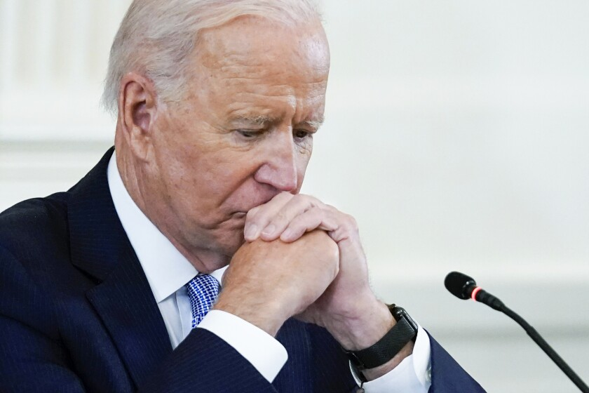 In this Sept. 24, 2021 photo, President Joe Biden listens during the Quad summit in the East Room of the White House. President Joe Biden's popularity has slumped — with half of Americans now approving and half disapproving of his leadership. That's according to a new poll by The Associated Press-NORC Center for Public Affairs Research. (AP Photo/Evan Vucci)