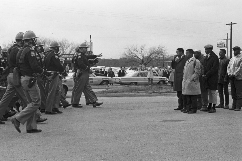 "Police officers confront protesters on Bloody Sunday in the documentary ""John Lewis: Good Trouble."""