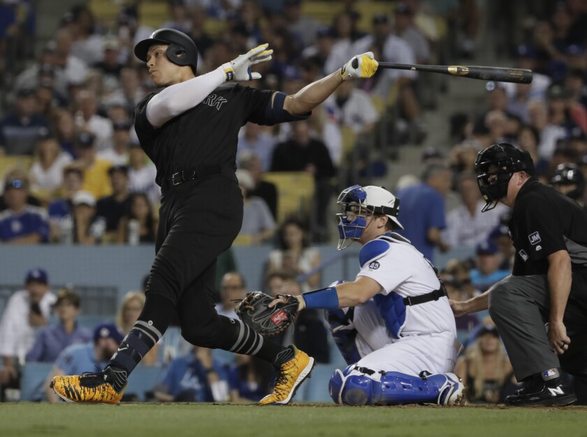 The Yankees' Aaron Judge homers at Dodger Stadium on Aug. 23, 2019.