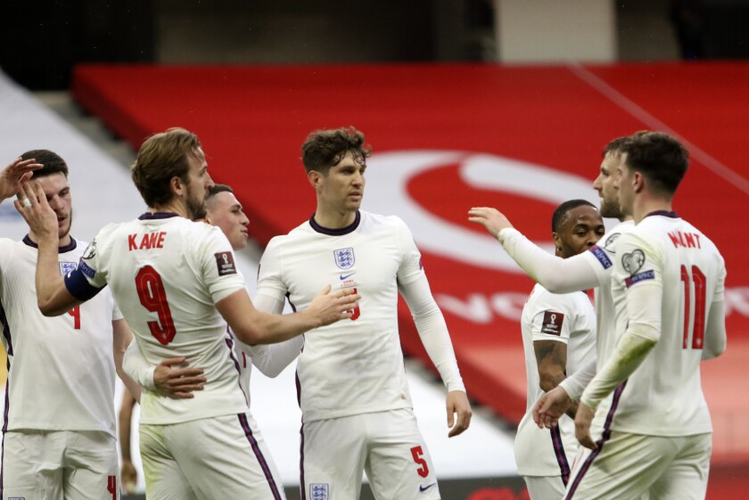 England's Harry Kane, left, celebrates with teammates his side's first goal during the World Cup 2022 group I qualifying soccer match between Albania and England at Air Albania stadium in Tirana, Sunday, March 28, 2021. England won 2-0. (AP Photo/Hektor Pustina)