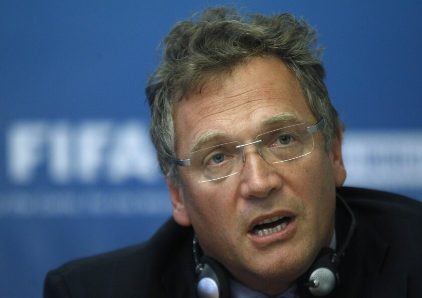FILE - In this Tuesday, Oct. 11, 2011 file photo, FIFA General Secretary Jerome Valcke speaks during a news conference on Russia's preparations for the 2018 FIFA World Cup in Moscow, Russia. Valcke says the 2022 World Cup in Qatar will not be held in June or July because of the Gulf country's summe